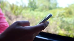 Female Passenger Using Mobile Phone in Train or Bus Beside Window - stock footage