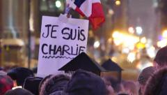 'Je suis Charlie'' vigil at night in winter with heat wave effects - Commercial Stock Footage