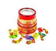 Sweets in the form of a barrel with scattered sweets Stock Photos