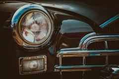 Vintage car headlight. Vintage effect processing - stock photo