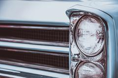 Vintage car headlight. Vintage effect processing Stock Photos