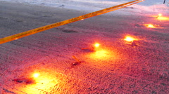 Police crime scene with flares on the ground and crime tape - Commercial Stock Footage