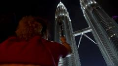 Woman Shooting with Camera Petronas Twin Towers at Night Stock Footage
