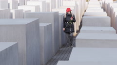 Berlin holocaust memorial monument woman praying for jews victims 4k Stock Footage
