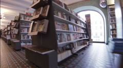 Shelves with books in a bookstore. Stock Footage