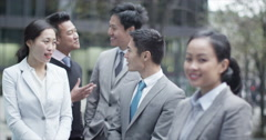 4K Portrait of smiling Asian businesswoman outdoors in the city with her team - stock footage