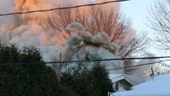 Strong winds creating beautiful motion effects in smoke from house fire Stock Footage