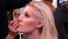 Stock Video Footage of Make up artist prepares Super model for Haute Couture catwalk high fashion