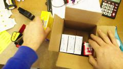 Packing items in a package Stock Footage