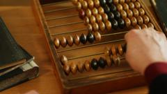 Using abacus or a counting frame on a table Stock Footage
