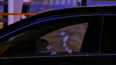 Bullet holes in car window at night with police lights and tape - Commercial - stock footage