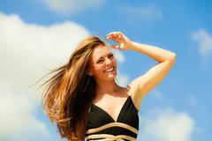 Happy woman on beach Stock Photos