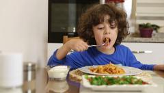 Little boy eating pasta. children eating appetite. dolly shot - stock footage
