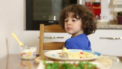 Little boy rejecting food. He does not want to eat. Stock Footage