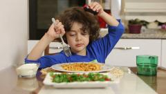 Little boy eating spaghetti. children eating appetite. boy playing with car. Stock Footage