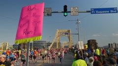 Spectators Cheer Pittsburgh Marathon Runners on Rachel Carson Bridge Stock Footage