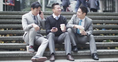 4K Portrait of cheerful Asian businessmen chatting outdoors in the city Stock Footage