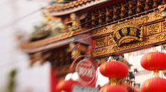 Tilt Shift Time Lapse of Chinese Temple in Yokohama Chinatown in Japan -Pan R- - stock footage