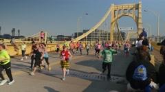 Spectators Cheer Pittsburgh Marathon Runners on Rachel Carson Bridge - stock footage