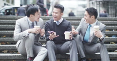 Stock Video Footage of 4K Portrait of cheerful Asian businessmen chatting outdoors in the city