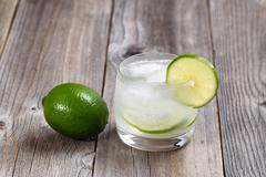 Ice cold Lime Drink on Rustic Wood Stock Photos