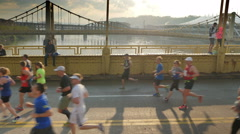 Pittsburgh Marathon Runners Cross Andy Warhol Bridge Stock Footage