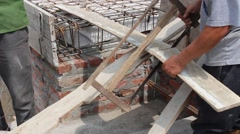 Construction workers build a building in construction Stock Footage