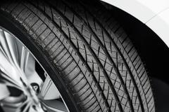 Brand New Car Tire Closeup Photo. Modern Car Tire Stock Photos