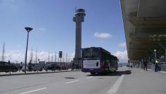 Airport main entrance bus passing Stock Footage