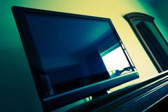 Flat Screen TV in a Room. Television Device. - stock photo