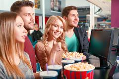 Group of people buying popcorn and coke - stock photo