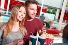 Couple buying popcorn and coke - stock photo