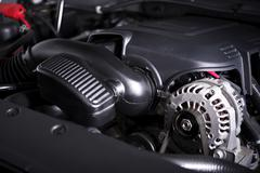Modern Car Alternator and Gas Engine. Stock Photos