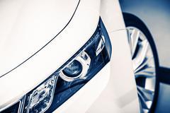 Modern Compact Car Headlight Closeup Stock Photos