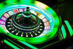 Colorful Neon Illuminated Roulette Casino Game - stock photo