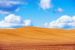 Scenic Stubble Farmland and the Blue Sky. Stock Photos