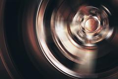 Spinning Car Wheel Closeup Photo. Car Alloy Wheel in Motion. Stock Photos