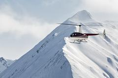 Helicopter flying in the mountains on the Kamchatka Peninsula. Far East Russia Stock Photos