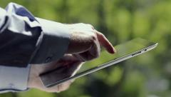 Close-Up Man Using Tablet In The Park Stock Footage