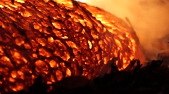 Pan/close up of lava oozing onto forest floor - Kilauea Hawaii - stock footage