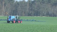 Spraying pesticides on a corn field Stock Footage