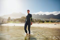 Triathlete in training at the beach - stock photo