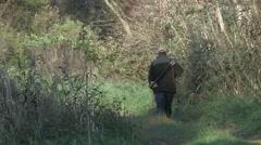 Hunter walking through nature - stock footage