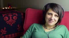Woman enjoy to listen fast and joyful music with headphone Stock Footage