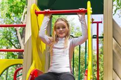 Active girl on nursery platform in summer Stock Photos