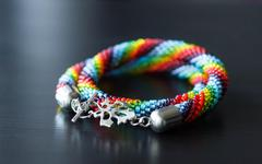 Necklace from multi-colored beads on a dark background Stock Photos