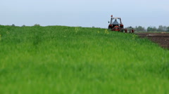 Spring sowing corn with a tractor and a planter Stock Footage