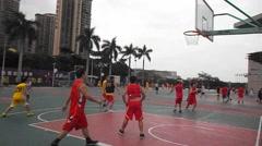 People playing basketball in Shenzhen, Baoan stadium, China - stock footage