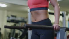 Attractive woman doing tricep dips in the gym Stock Footage