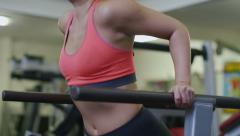 Attractive woman doing tricep dips in slow motion Stock Footage